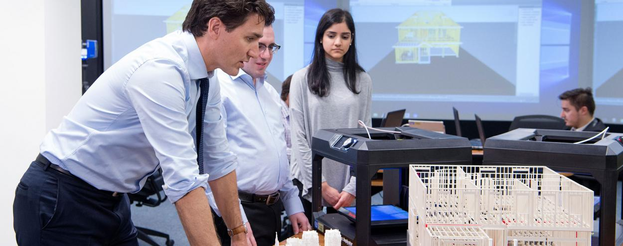 Prime Minister Justin Trudeau in BIM lab with two students