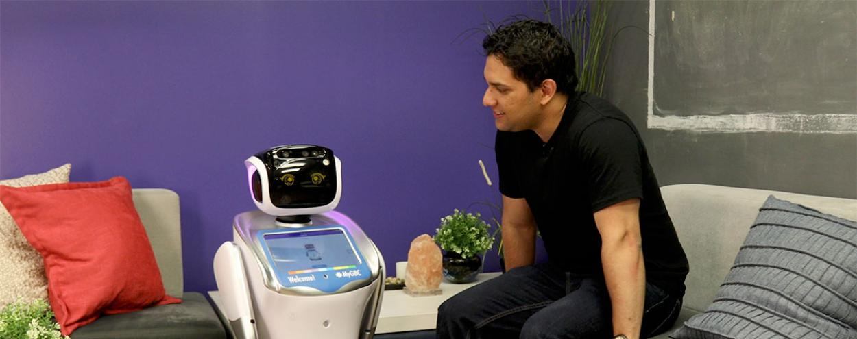 Georgie robot with person