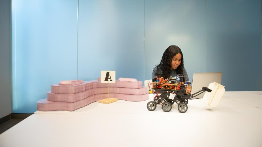Engineering student Daviann Coore working with robot