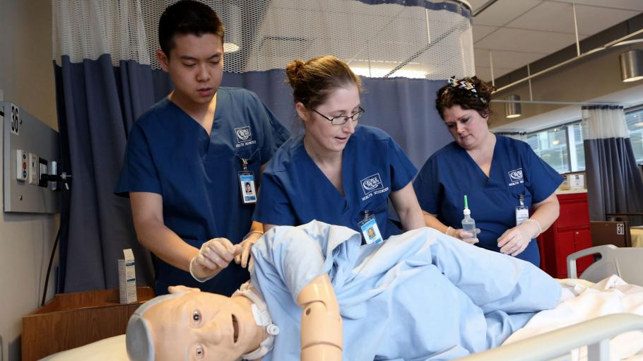 Personal Support Worker students practice on low fidelity mannequin in the Simulation Centre on Waterfront Campus.