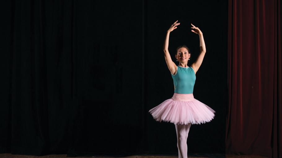Female dancer student who is performing ballet on stage.