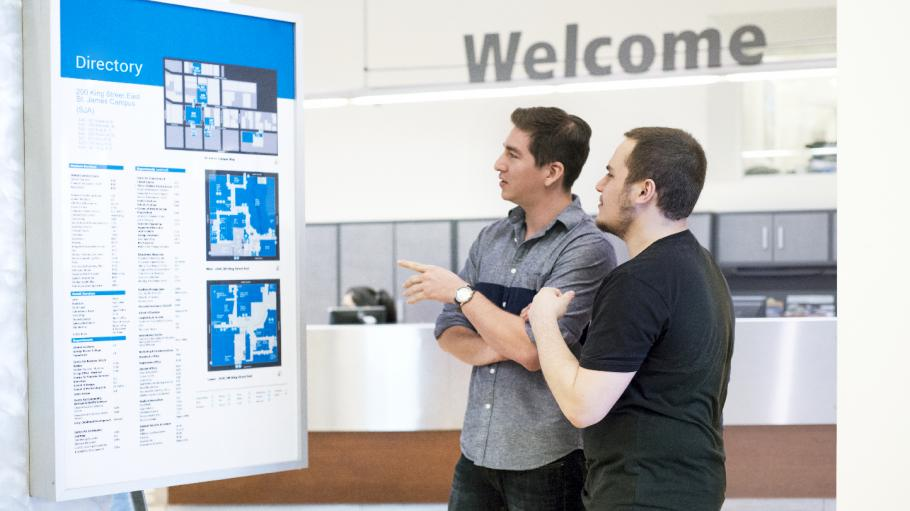 2 students looking at a campus map in the Welcome Centre
