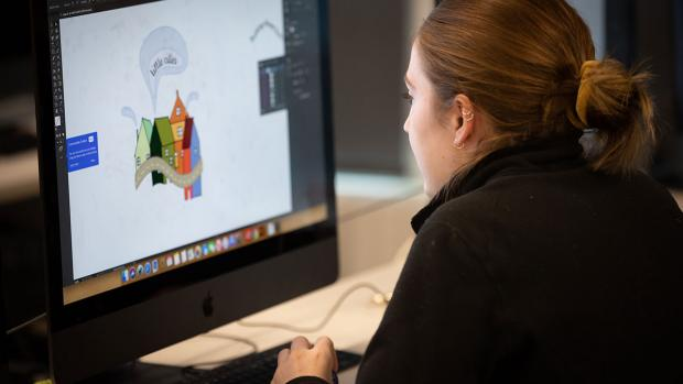 design student working on computer