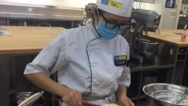 Masked baking student in lab