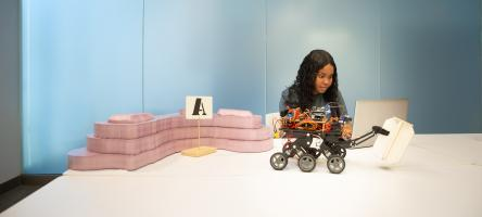 Mechanical Engineering student Daviann Coore working with robot